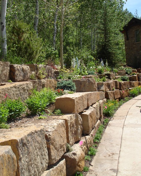 Perennial garden planted throughout a stone retaining wall in Aspen, Colorado.